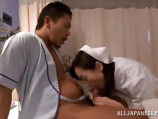 Horny japanese nurse here is stuffing her pretty mouth with his patient's huge dick right in the hospital. Then she lay down and let her guy to s