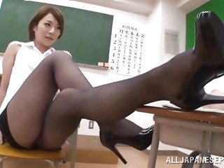 Tamaki Nakaoka has made a student stay after class because he was misbehaving. She makes him do his homework and as he does it she puts her nylon cove