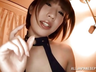 This sexy Japanese race queen likes to look of this guy's tiny cock, and she wants to suck on it. She looks super sexy in her outfit. Watch as sh