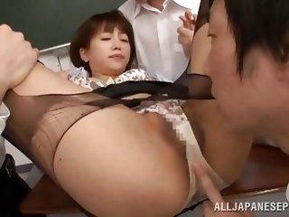 Saki Ninomyia is teaching her class when the male students get really horny. They push her down onto her desk and tear her skirt and blouse. They rip