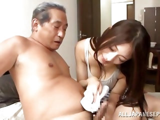 This sexy Japanese brunette takes out a nice warm towel and wraps it around her old husband's cock. She washes his penis to get it nice and clean