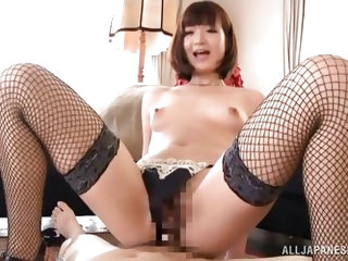This sexy Japanese whore opens her legs so her man can play with that hairy pussy of hers. She's really wet and horny now, so she climbs on his c