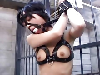 An Asian slutty babe with small tits, coming out of a kinky bra, is kept isolated. Her hands are strongly tied up. Watch her nipples and pussy stimula