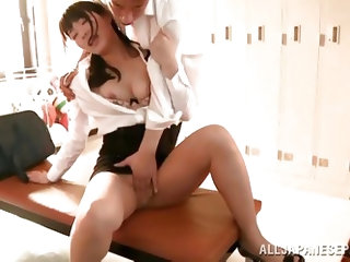 After class Kana Yume meets one of her students. She lets him open her blouse to see her perky and round boobs. They kiss hard and he pinches her nipp