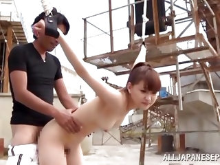 Yukiko Suo has her arms tied up with rope and she's hung from a bridge. She gets her hairy pussy fingered by her boyfriend and then he fucks her