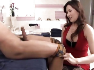 Watch how she undresses her man and when she reaches his hard dick, this cunt admires it before giving it a suck. She looks damn fine in that elegant