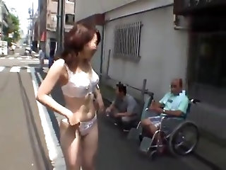 Japanese girl strips naked in crowded area